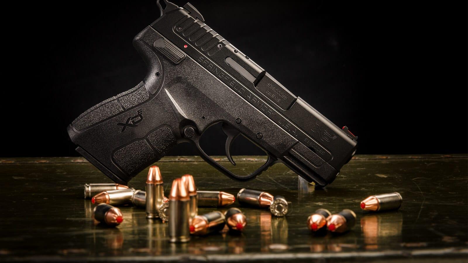 Springfield XD-E with 9mm Hornady ammunition on table