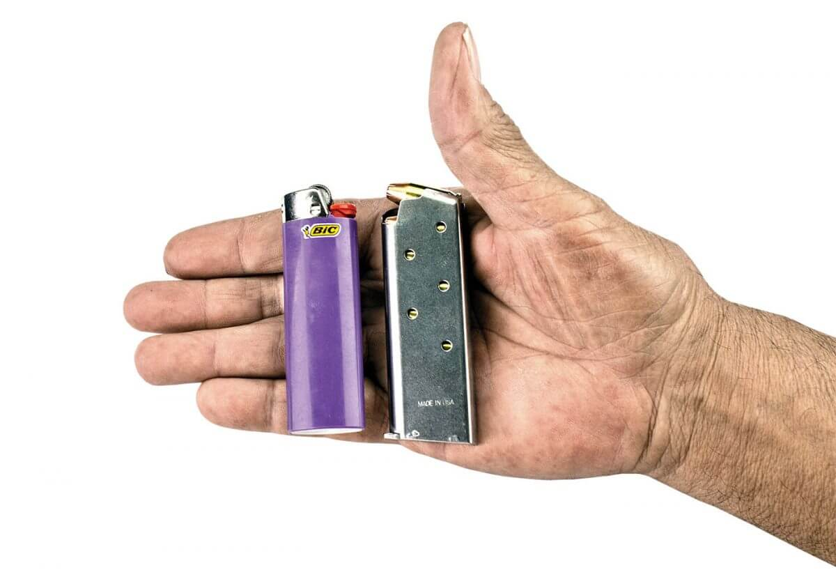 Demonstrating the small size of the 911 magazine