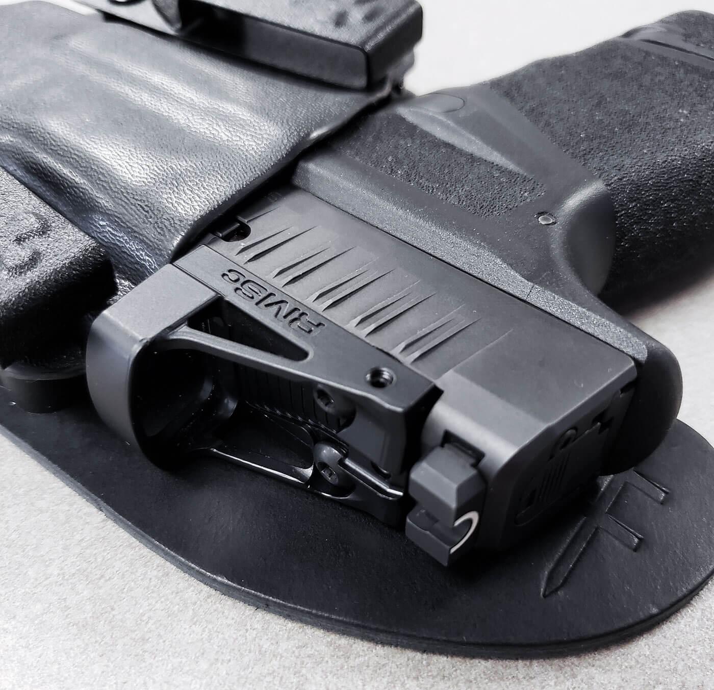 Hellcat pistol in a CrossBreed Reckoning holster