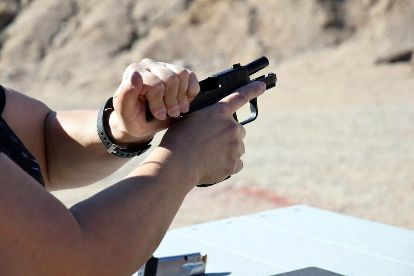 Working the handgun slide