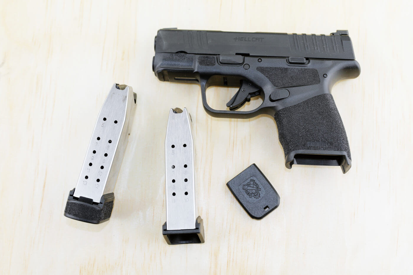 Hellcat backup gun shown with two magazines