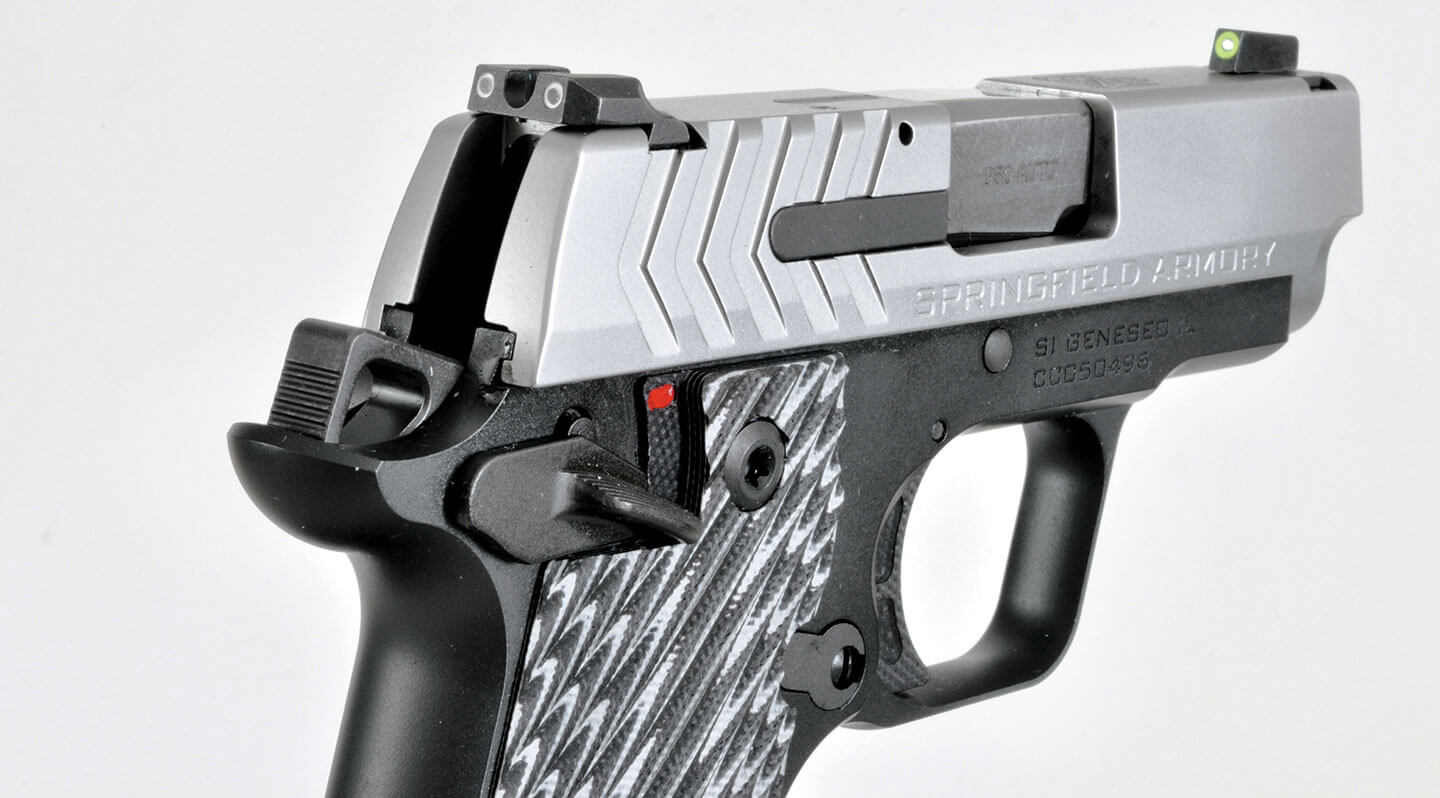Close-up view of the Ameriglo Pro-Glo sights on the stainless steel 911 slide