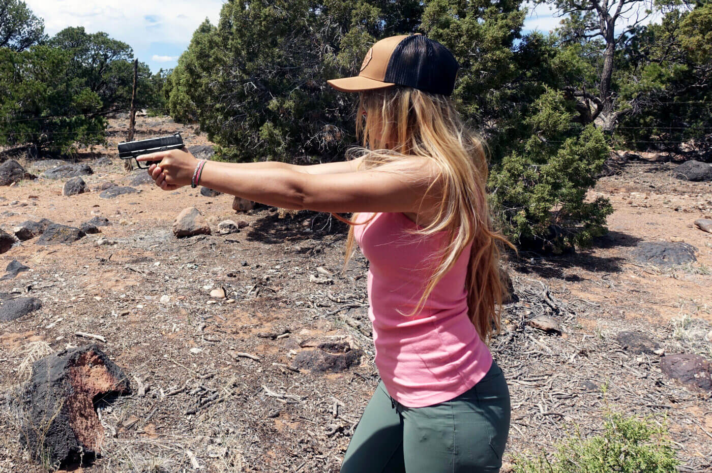 Woman shooting Springfield Hellcat