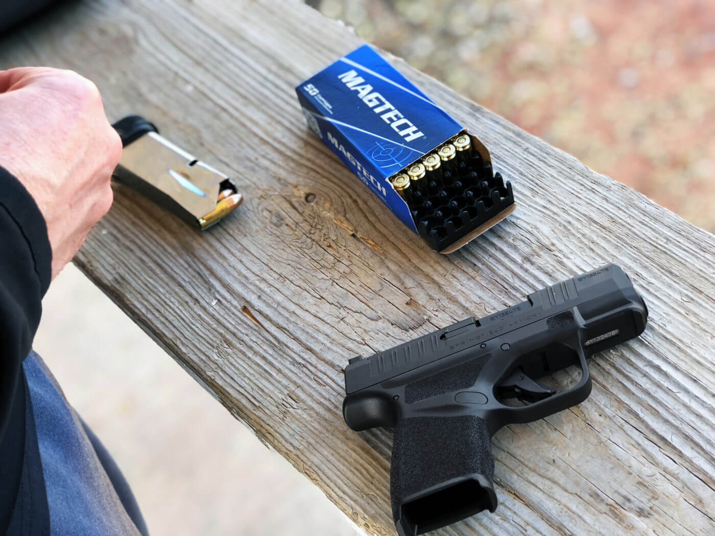 Loading the magazine of the micro compact 9mm Hellcat