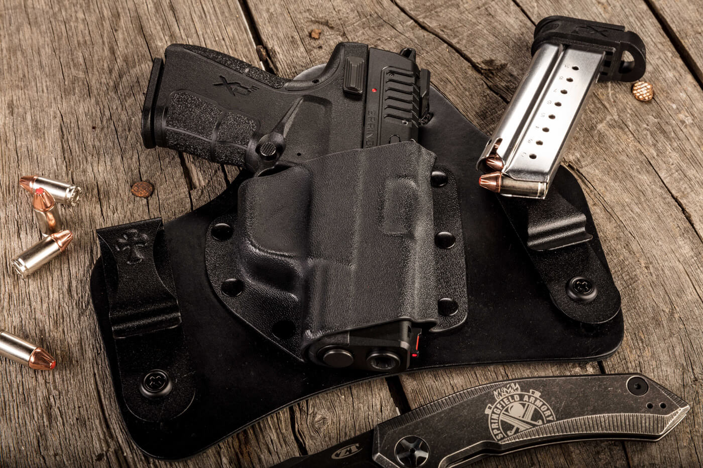 Springfield Armory 9mm CCW pistol in a Crossbreed Holster with a knife