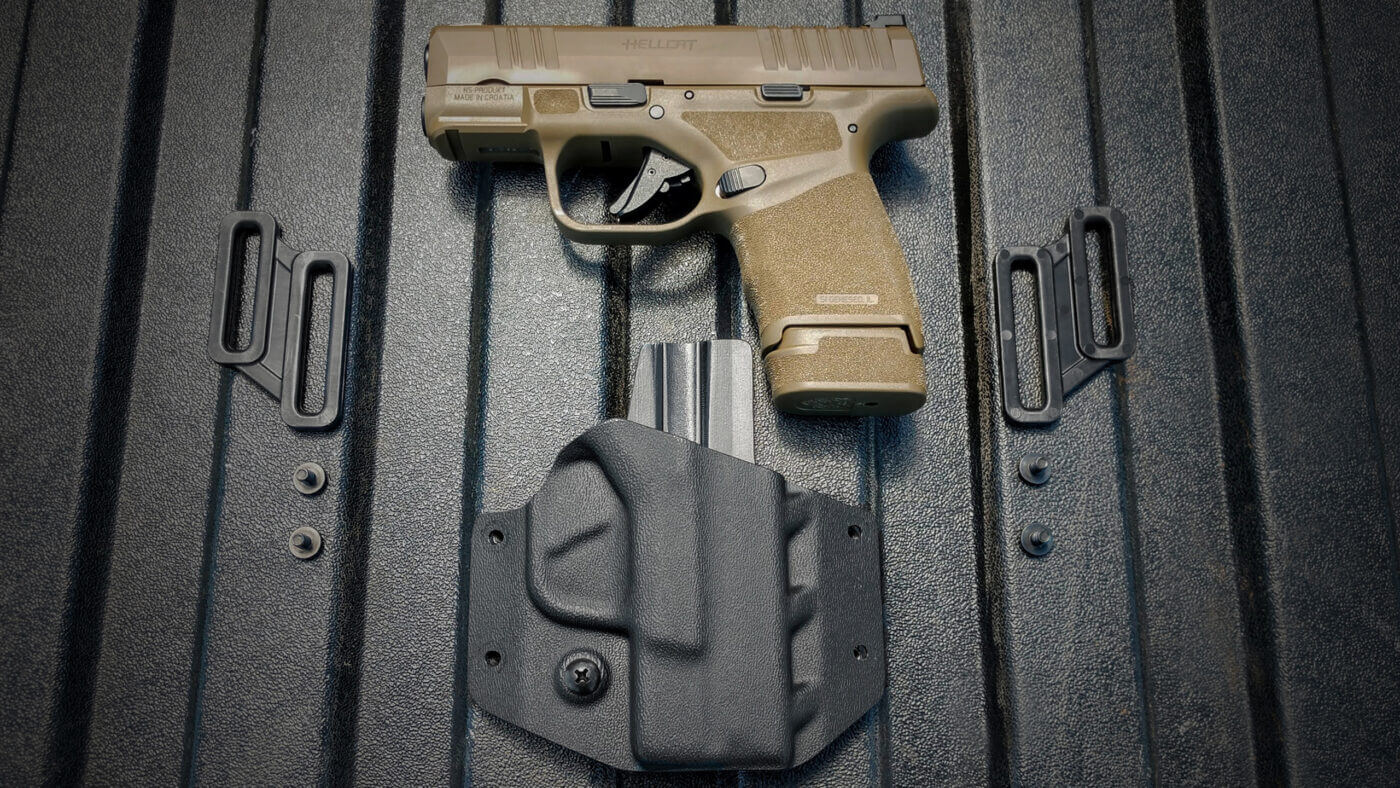 Crucial Concealment Covert OWB Holster with Springfield Hellcat pistol