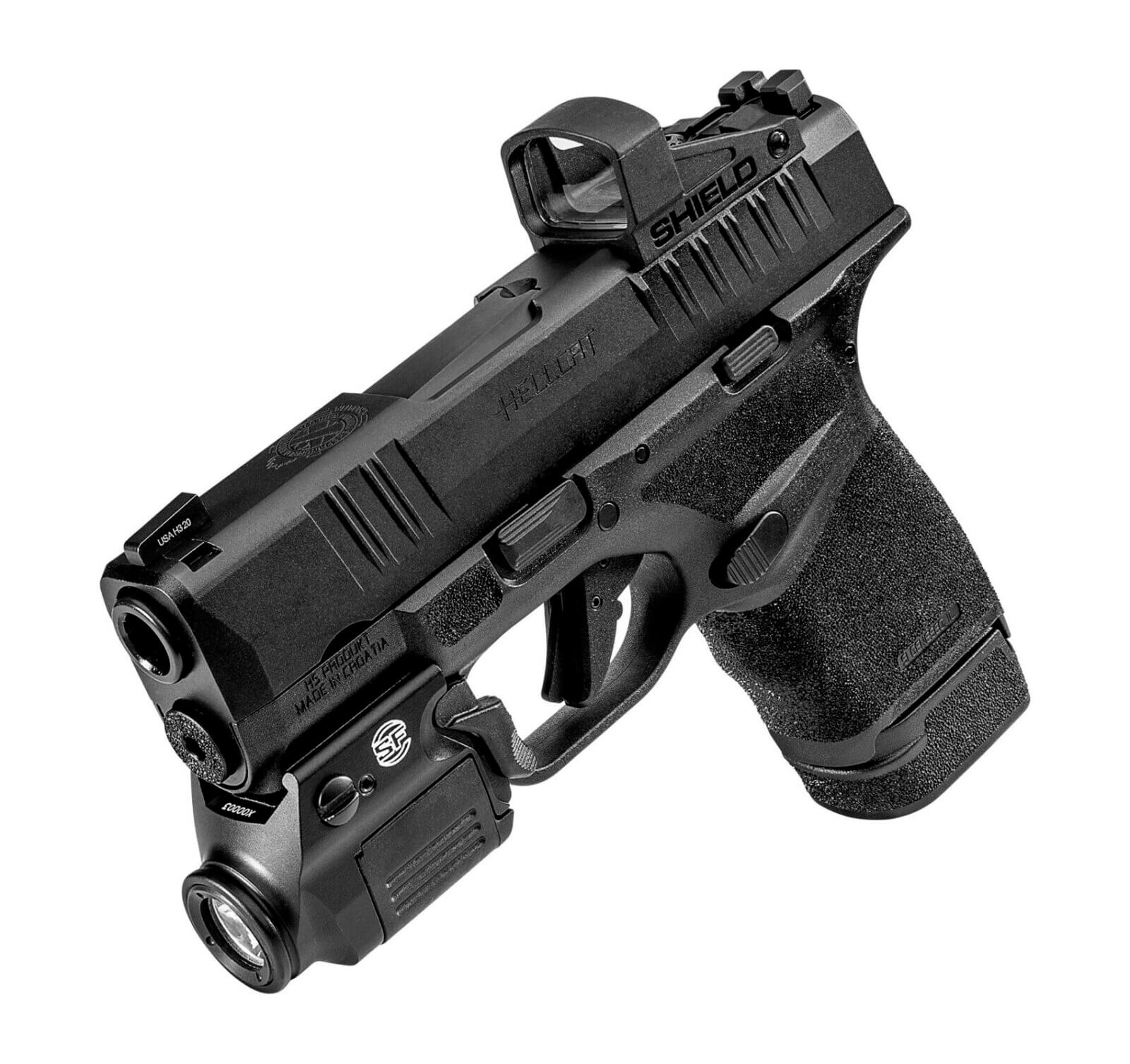 Springfield Hellcat fitted with a Shield red dot and a SureFire XSC flashlight