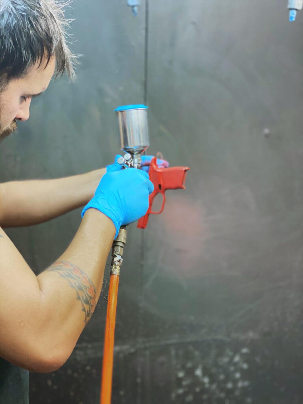 Applying a custom Cerakote finish to a pistol