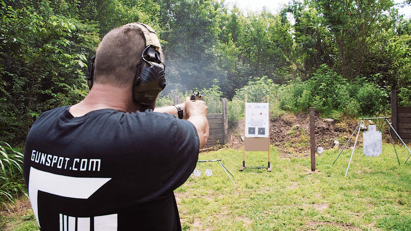 Over the shoulder view of shooting a target