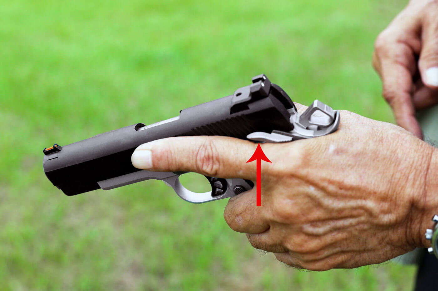 Ayoob shows how to engage the 1911 thumb safety with one hand