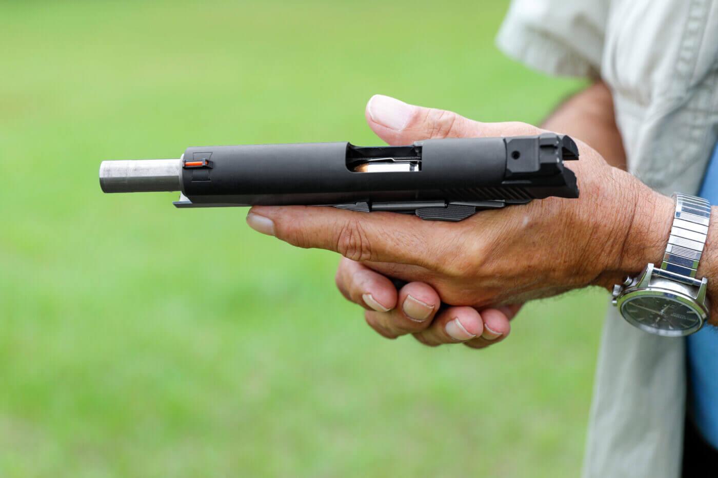 Left handed reload of pistol