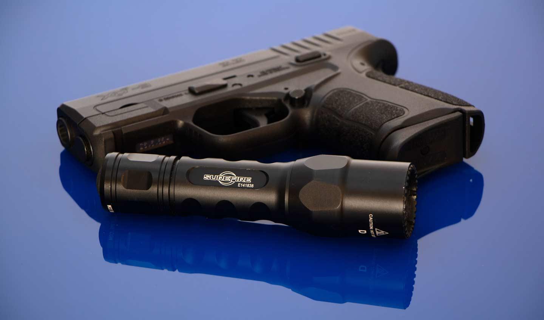 Hand-held home defense flashlight