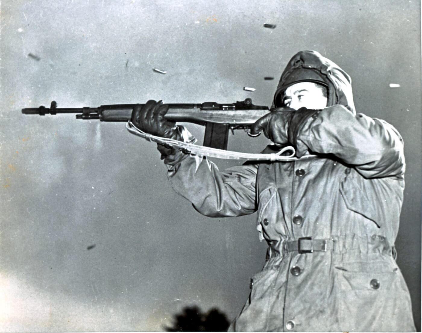 U.S. soldier firing an M14 in January 1952