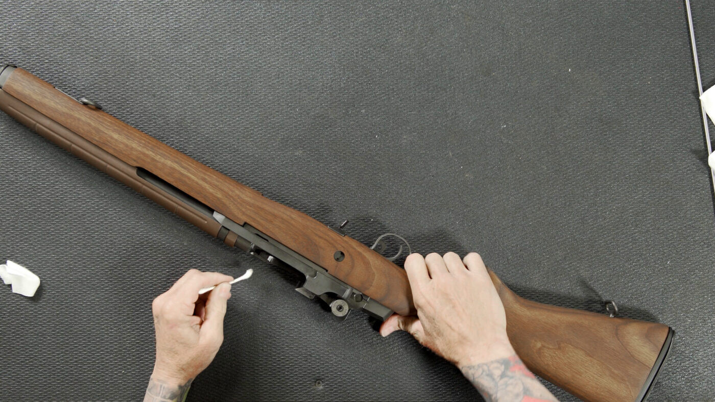 Using a Q-tip to clean the M1A