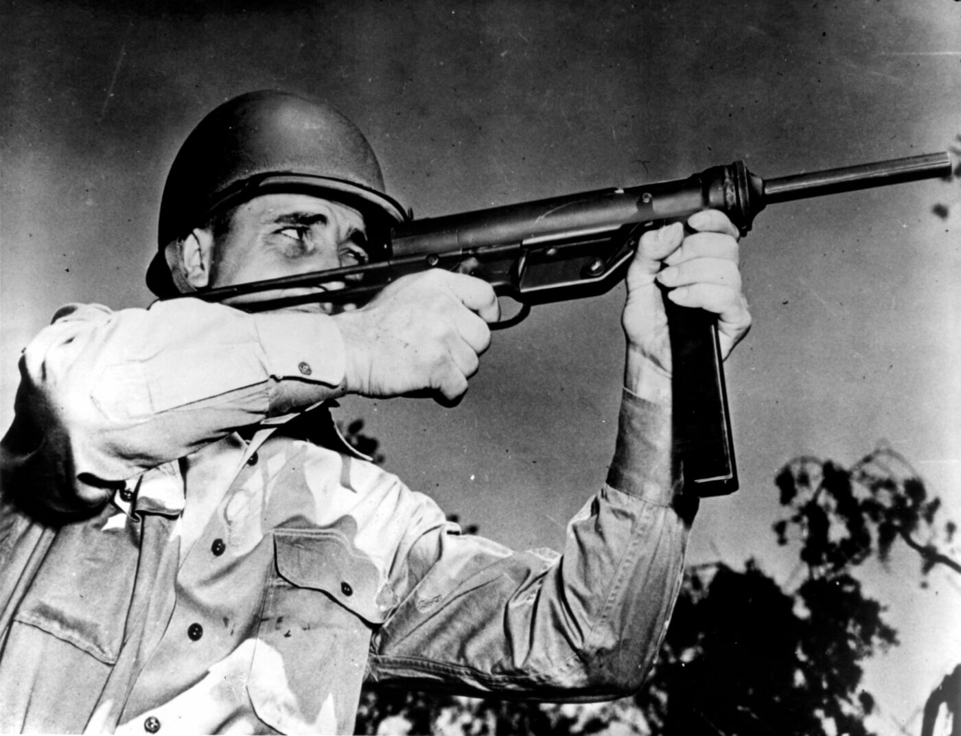 M3 Grease Gun being fired by a soldier in WWII