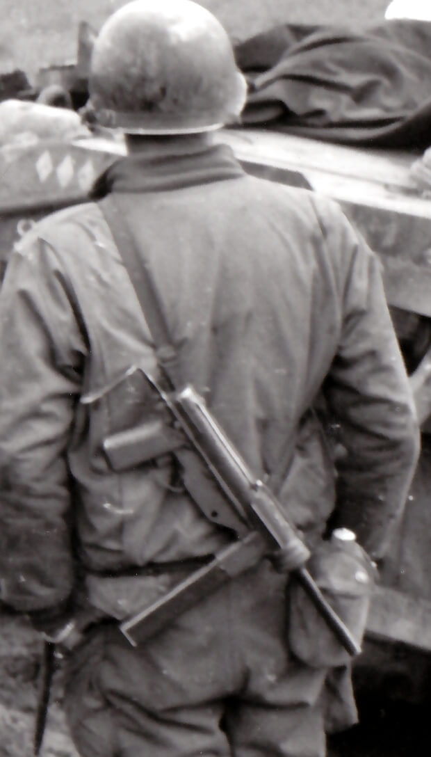 M3 SMG field-modified with a slotted receiver to accept a traditional cocking handle