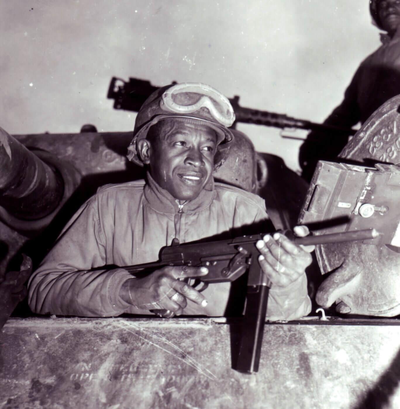 Black tank crewmen with M3 SMG