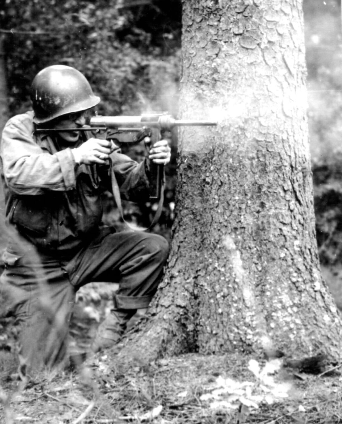 Soldier shooting M3 SMG in World War II