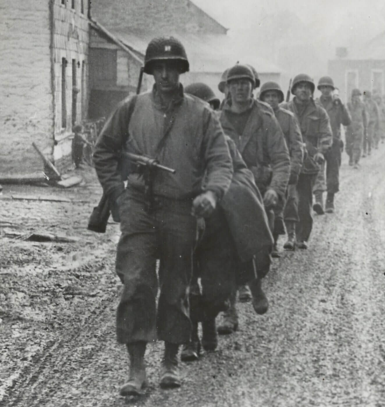 The Battle of the Bulge: M3 SMG leading the march out of St. Vith. Image: NARA