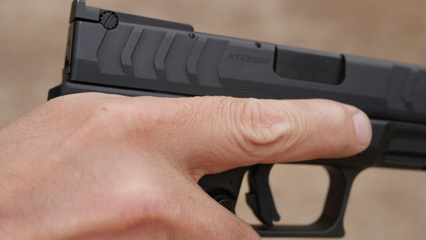 High hold grip of pistol for recoil control