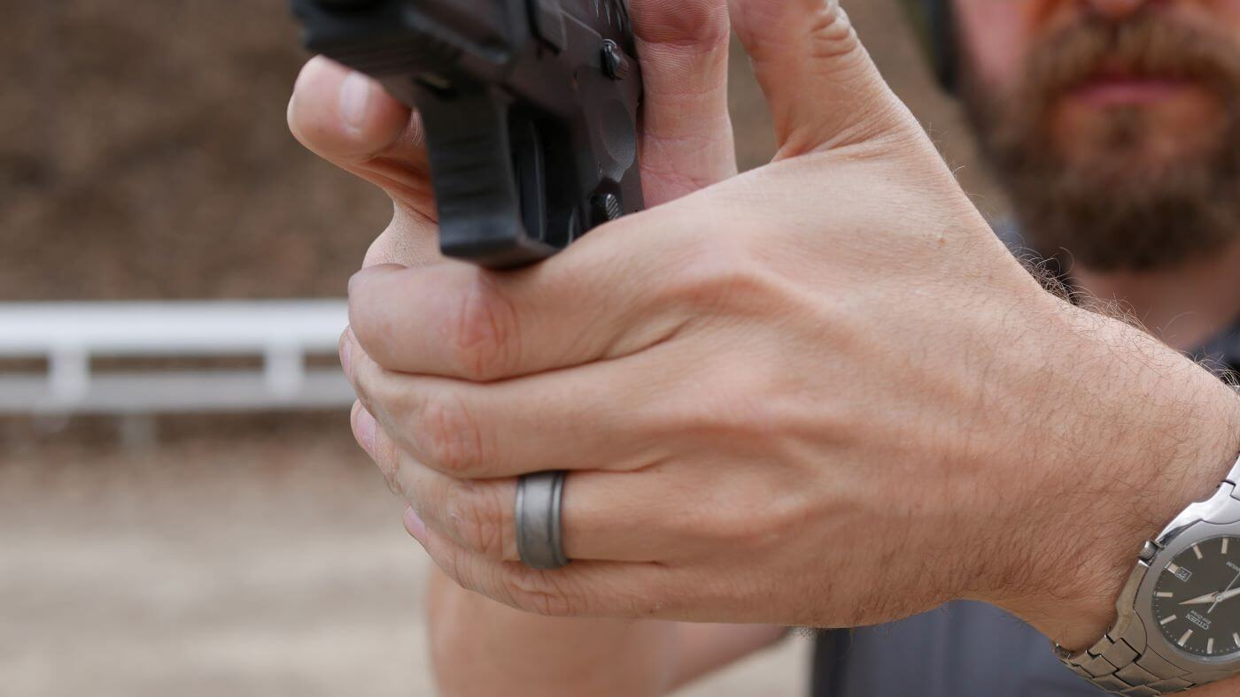 Proper two-handed grip for recoil management