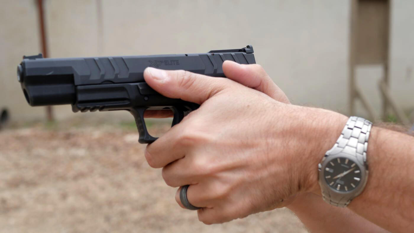 Correct two-handed pistol grip for recoil control