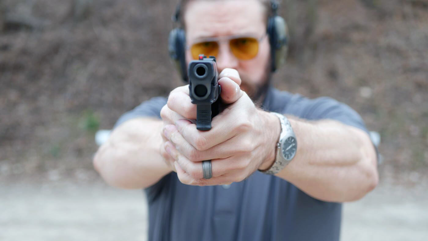 Elbow positioning for recoil reduction when shooting a handgun