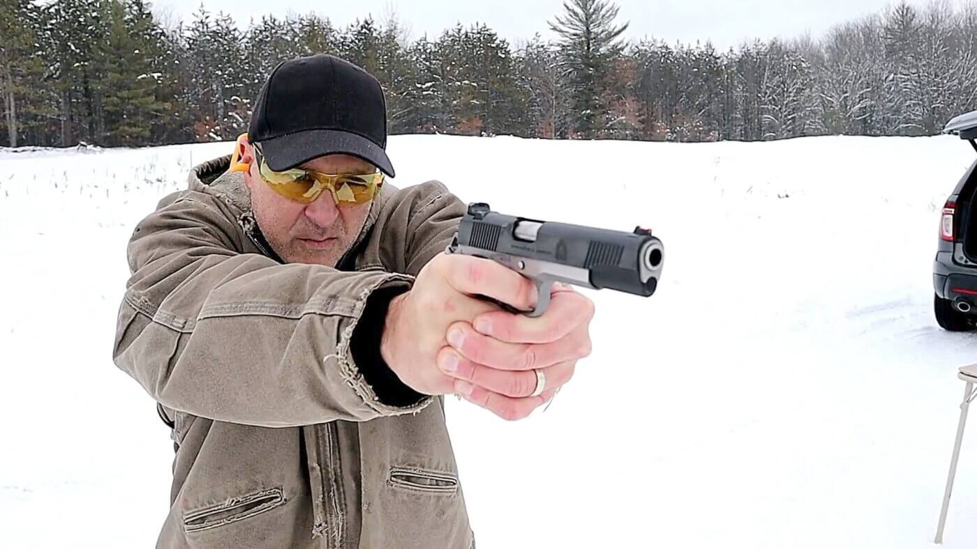 Shooting a 1911 Ronin with two hand grip