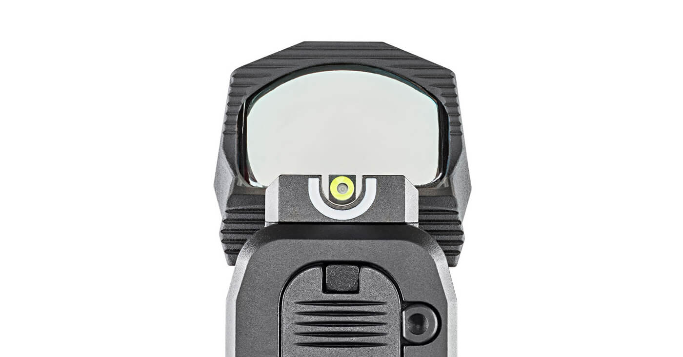 HEX Wasp optic mounted to Hellcat pistol slide while co-witnessing U-Dot sights