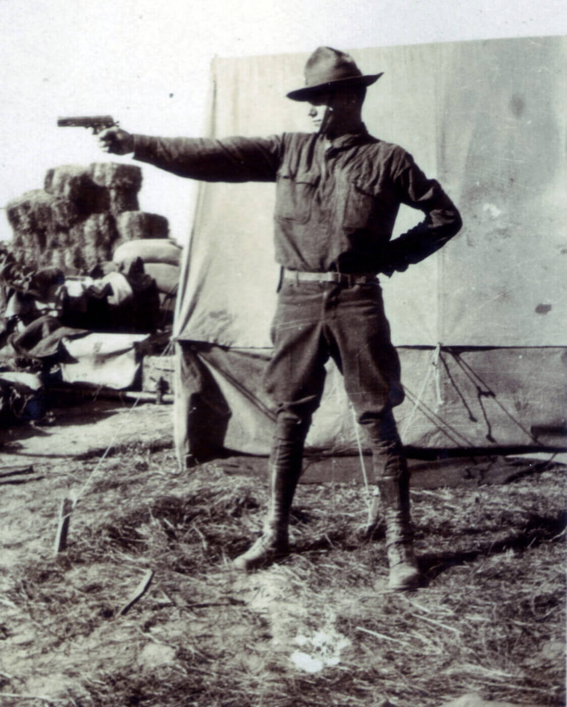 US soldier shooting a M1911 in WWI
