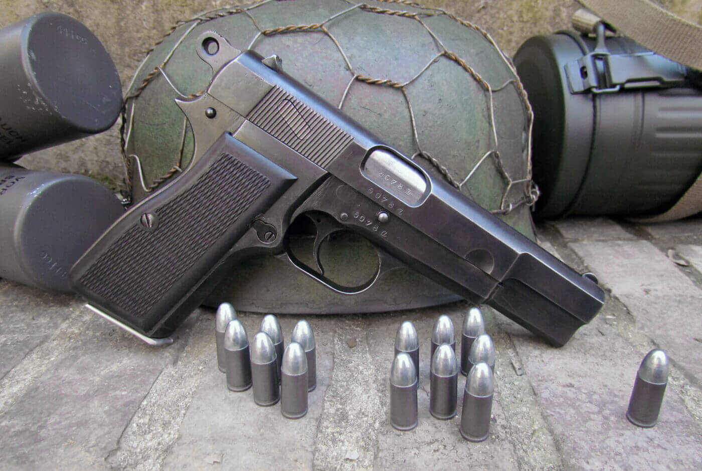 Browning Hi-Power with helmet and ammo