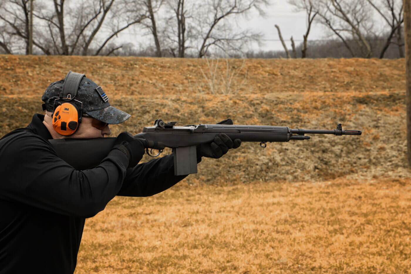 Springfield Armory M1A Loaded shot by a man in the field