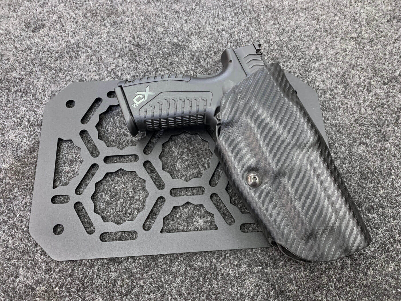 Mounting a holster to the Adapt-A-Panel