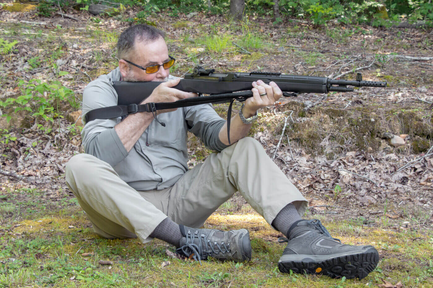 Shooting a rifle while sitting