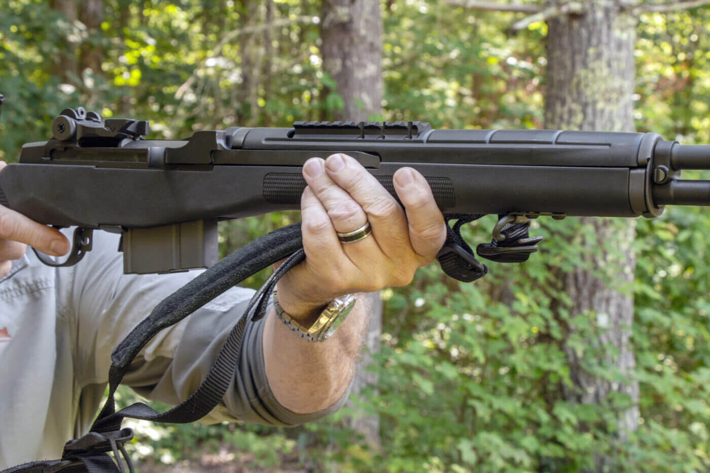 Man demonstrating how to hold a rifle