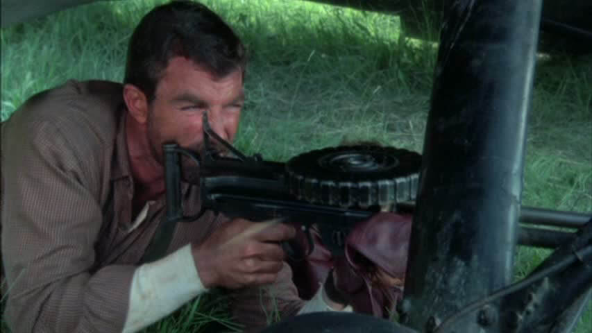 Tom Selleck fires a Lewis Gun