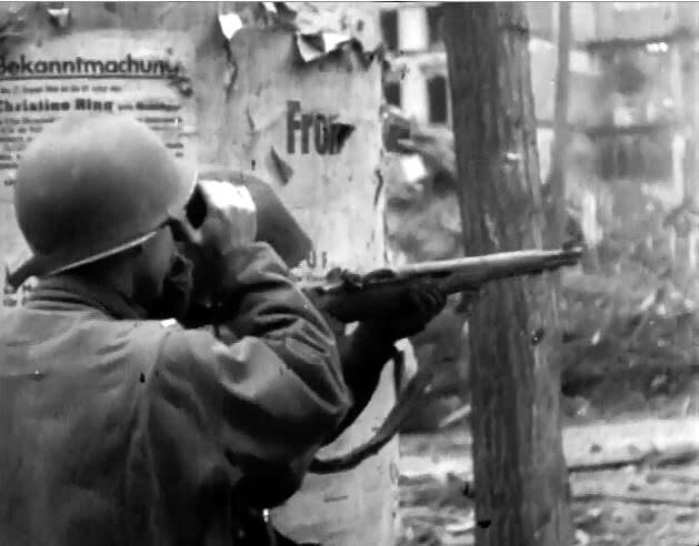 US soldier shooting an M1 Garand sniper rifle