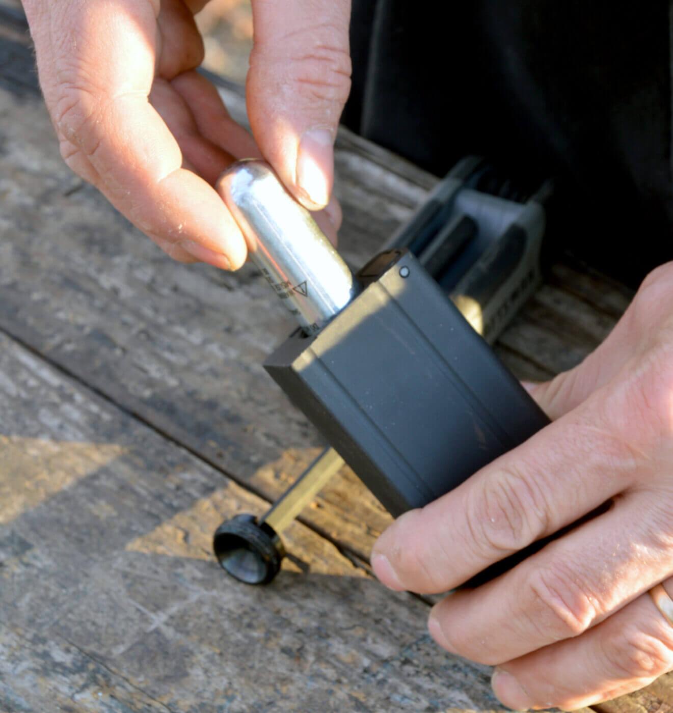 Inserting air cylinder in M1 BB gun