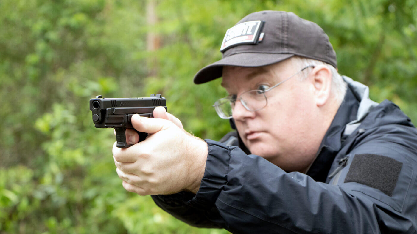 Man shooting a Springfield Armory XD 9mm pistol