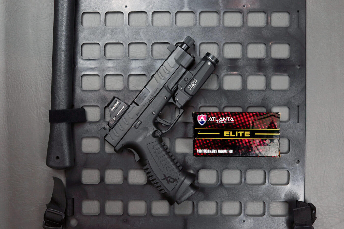 Streamlight TLR-9 on a pistol next to Atlanta Arms ammo
