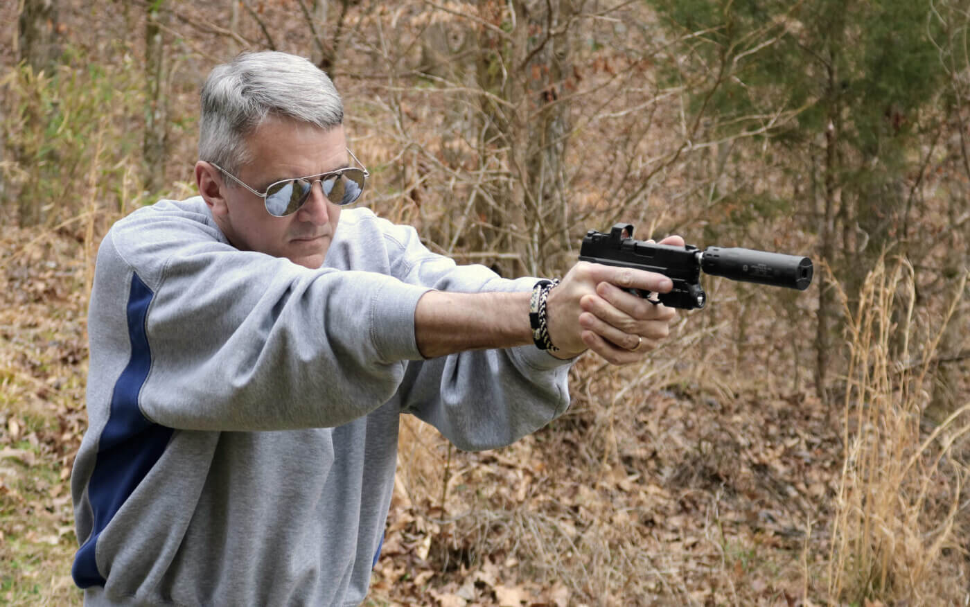 Shooting a Hellcat RDP pistol with suppressor attached