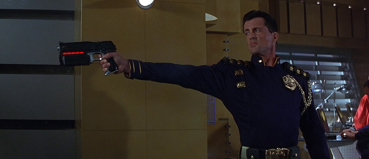 Stalone with Lawgiver pistol in Judge Dredd