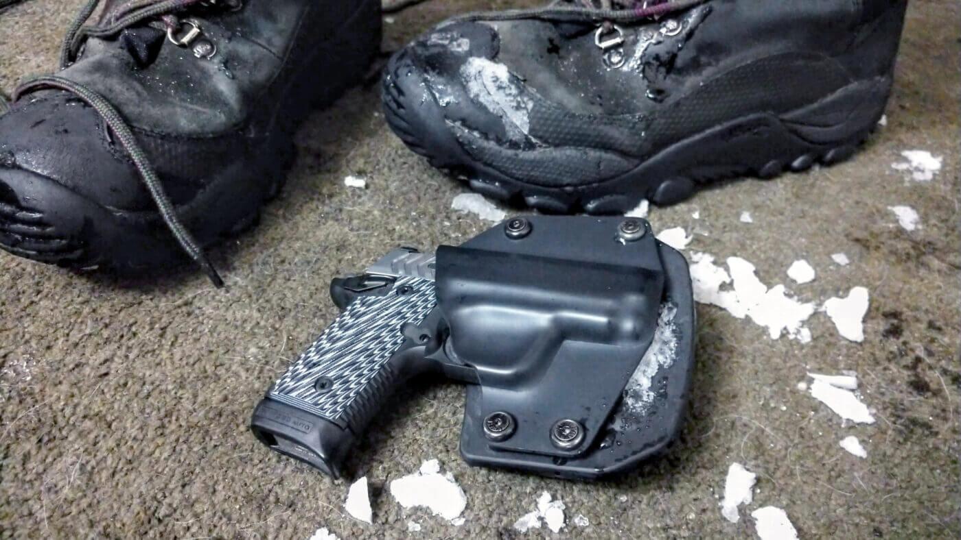 Springfield Armory pistol on floor with snow