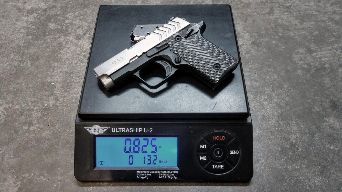 Springfield 911 pistol on scale