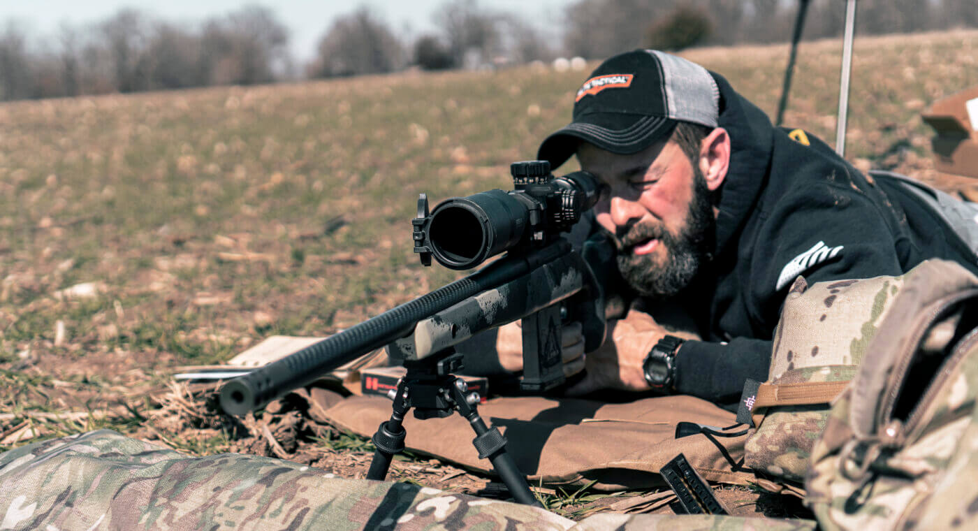 Man shooting Waypoint rifle with Bushnell Elite scope