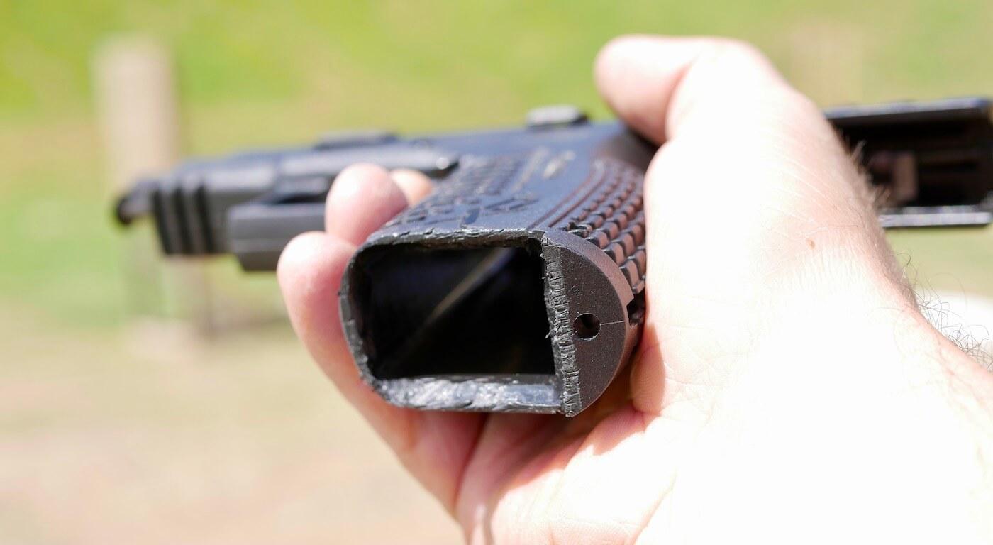 Magazine well on pistol