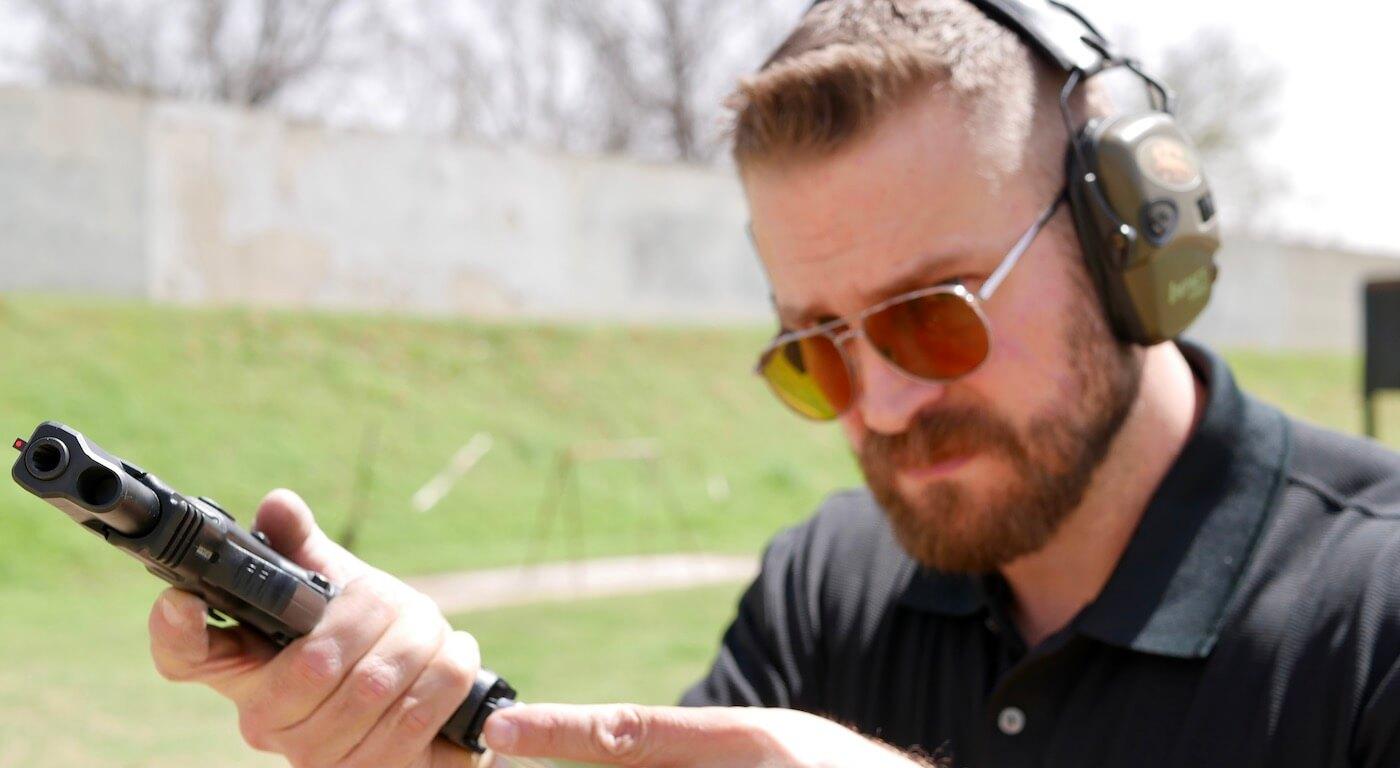 Putting magazine into a handgun