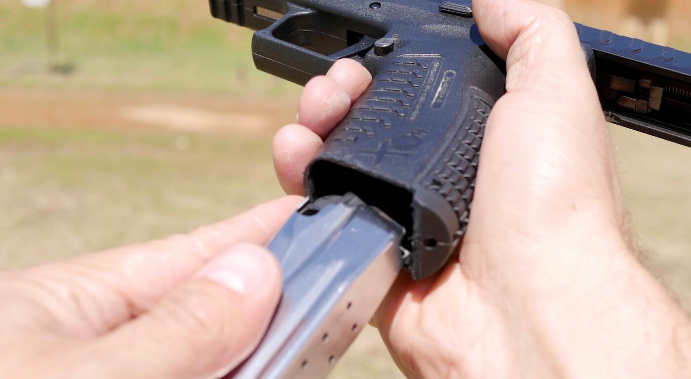 Using pointer finger during pistol reload