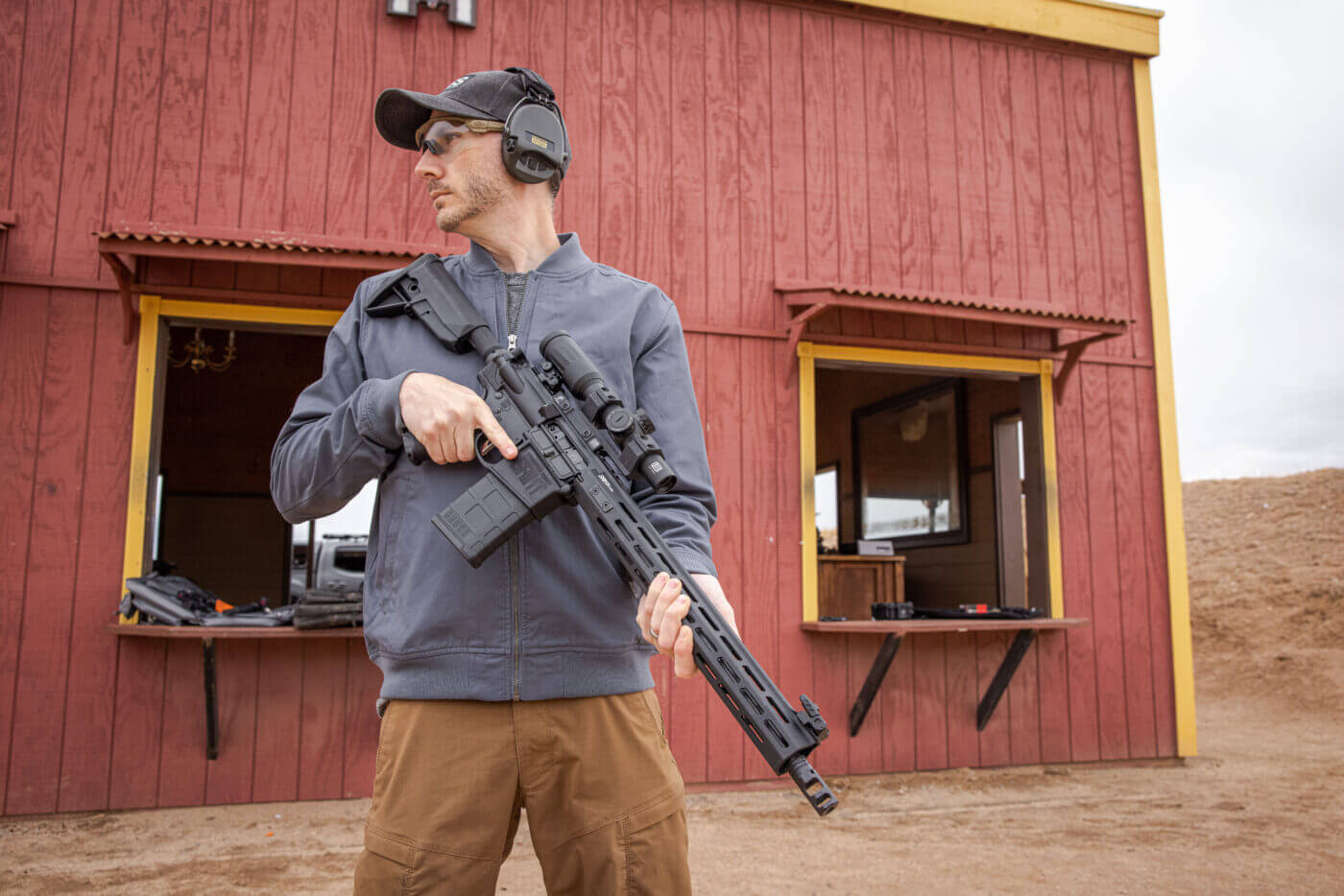 Man holding AR-15 rifle in .308 Win