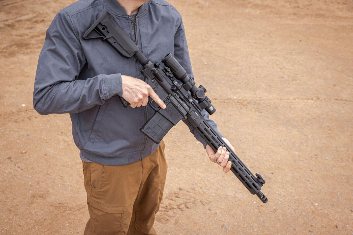 Man holding SAINT Victor .308 rifle